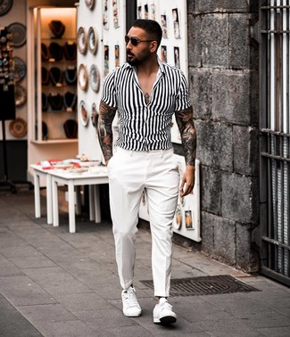 How to wear: white and black vertical striped short sleeve shirt, white dress pants, white leather low top sneakers, dark brown sunglasses