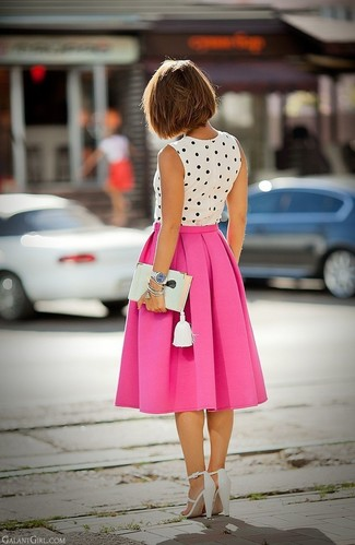 Make a blouse and a neon pink pleated midi skirt your outfit choice for an effortless kind of elegance. Grab a pair of white leather heeled sandals to instantly up the chic factor of any outfit.