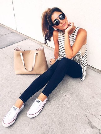 A white and black striped tank and black slim jeans are a perfect combination to be utilised at the weekend. Finish off your look with white canvas low top sneakers.