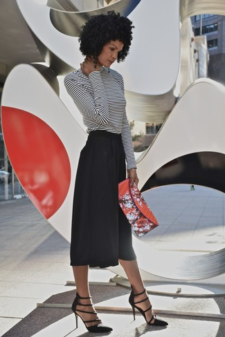 Nail glam in a monochrome striped turtleneck and black culottes. Why not introduce black cutout suede pumps to the mix for an added touch of style?
