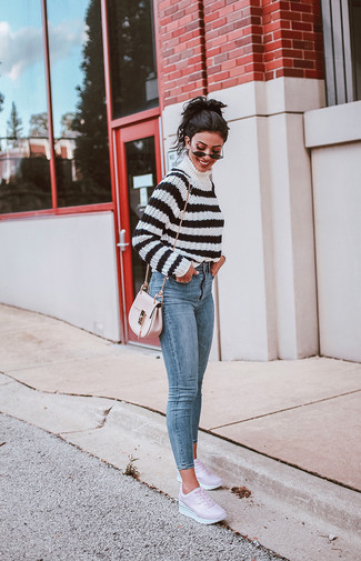How to wear: white and black horizontal striped turtleneck, light blue skinny jeans, pink leather low top sneakers, pink leather crossbody bag