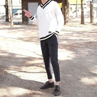 How to Wear Black and White Vertical Striped Chinos: Pairing a white and black v-neck sweater with black and white vertical striped chinos is an on-point pick for a casual and cool outfit. For a classier aesthetic, complete your look with a pair of dark brown leather brogues.
