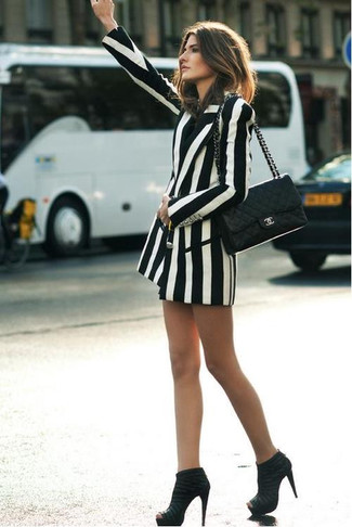 A white and black vertical striped double breasted blazer will give off this very sexy and chic vibe. This outfit is complemented perfectly with black suede ankle boots.