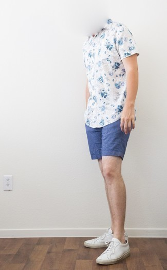 White and Red Leather Low Top Sneakers Outfits For Men: The combination of a white and blue floral short sleeve shirt and blue linen shorts makes for a knockout off-duty ensemble. White and red leather low top sneakers act as the glue that brings this ensemble together.