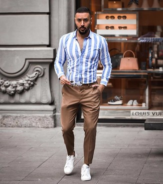 How to Wear a White and Blue Vertical Striped Long Sleeve Shirt For Men: A white and blue vertical striped long sleeve shirt and brown chinos are a nice look to keep in your casual arsenal. Let your styling chops truly shine by rounding off this getup with a pair of white leather low top sneakers.