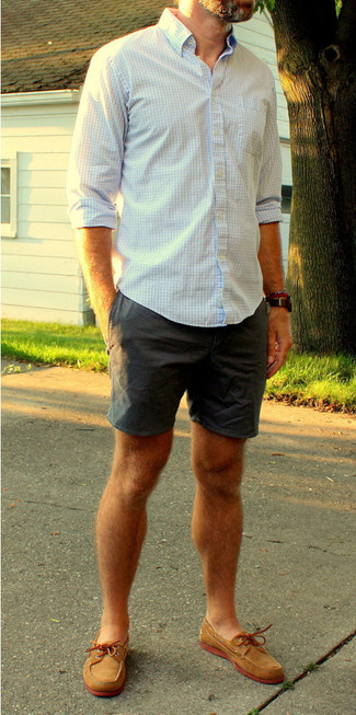 A white and blue gingham long sleeve shirt and shorts is a great combo to add to your casual lineup. Finish off this look with brown leather topsiders.