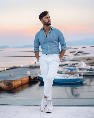 White Canvas High Top Sneakers Outfits For Men: To create a casual ensemble with a modern take, make a white and blue vertical striped long sleeve shirt and white chinos your outfit choice. To inject a more laid-back finish into this outfit, introduce a pair of white canvas high top sneakers to the equation.