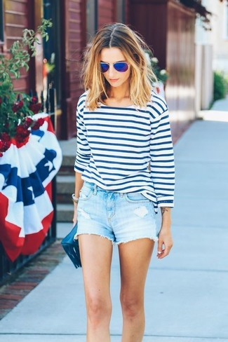 How to wear: white and blue horizontal striped long sleeve t-shirt, light blue denim shorts, navy leather clutch, blue sunglasses