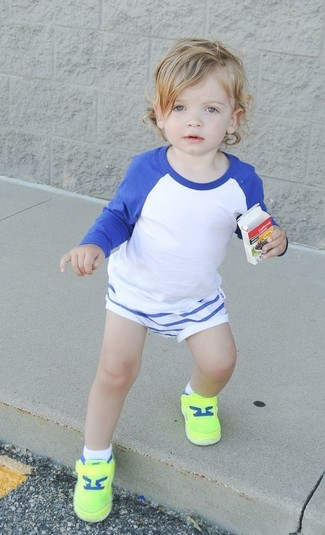 How to Wear White Shorts For Boys: A white and blue long sleeve t-shirt and white shorts are a nice outfit for your little guy to wear when you go on walks. Finish this look with green-yellow sneakers.