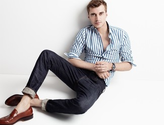 How to wear: white and blue vertical striped long sleeve shirt, black jeans, brown leather loafers
