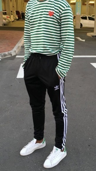 White and Green Leather Low Top Sneakers Outfits For Men: Make a white and green horizontal striped long sleeve t-shirt and black sweatpants your outfit choice for a stylish and easy-going getup. For a dressier vibe, why not complement this getup with a pair of white and green leather low top sneakers?