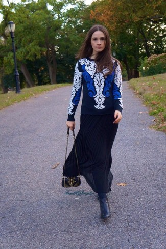 How to wear: white and navy embroidered crew-neck sweater, black pleated maxi skirt, black leather ankle boots, black studded leather crossbody bag