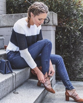 How to wear: white and navy horizontal striped crew-neck sweater, navy skinny jeans, brown suede pumps, navy leather crossbody bag