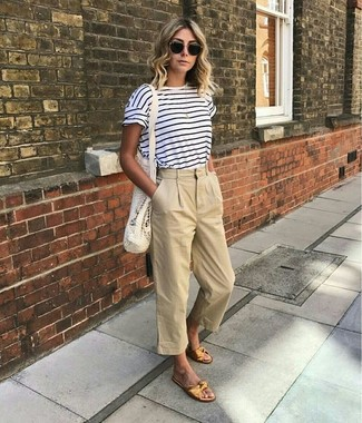 How to Wear a White and Navy Horizontal Striped Crew-neck T-shirt For Women: Consider teaming a white and navy horizontal striped crew-neck t-shirt with beige culottes to get a casual and comfortable outfit. Introduce a pair of gold leather flat sandals to the mix for extra fashion points.