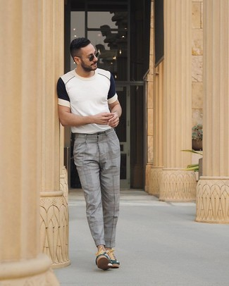How to wear: white and navy crew-neck t-shirt, grey plaid dress pants, dark green low top sneakers