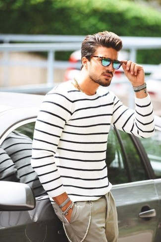 How to wear: white and navy horizontal striped crew-neck sweater, beige chinos, blue sunglasses