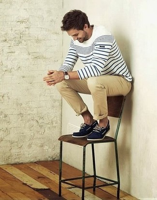 How to wear: white and navy horizontal striped crew-neck sweater, khaki chinos, navy suede boat shoes
