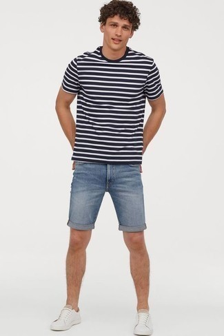 How To Wear Light Blue Denim Shorts With White Sneakers In Your 20s For Men: For a laid-back getup, wear a white and navy horizontal striped crew-neck t-shirt with light blue denim shorts — these items go wonderfully together. Rounding off with white sneakers is a guaranteed way to inject a more laid-back feel into your ensemble.