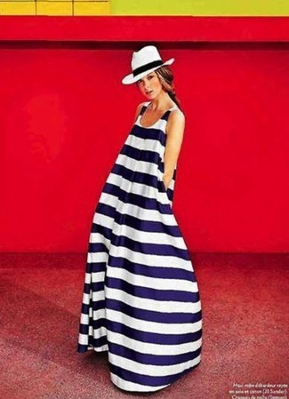 Make a white and navy horizontal striped maxi dress your outfit choice for a trendy and easy going look. We love how ideal this getup is when hot weather hits.