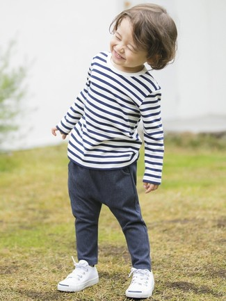Boys' Looks & Outfits: What To Wear In Summer: Let your munchkin perfect the smart casual look in a white and navy horizontal striped t-shirt and navy denim trousers. This look is complemented nicely with white sneakers.