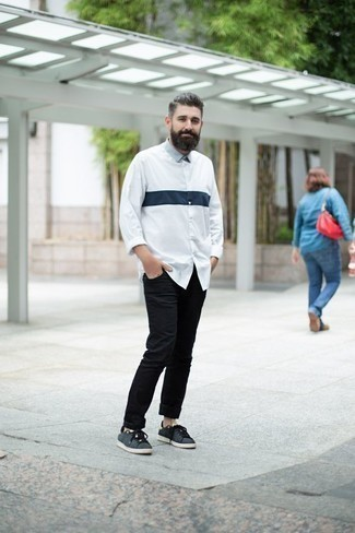 How to Wear Black Jeans In Warm Weather For Men: If you're after a casual yet on-trend ensemble, wear a white and navy long sleeve shirt with black jeans. Complement this ensemble with a pair of charcoal canvas low top sneakers and ta-da: your outfit is complete.