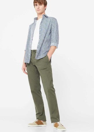 Make a white and navy long sleeve shirt and olive chinos your outfit choice to bring out the stylish in you. A pair of beige plimsolls fits right in here. As full-blown summer settled in, it's time for easy and breezy looks like this one.