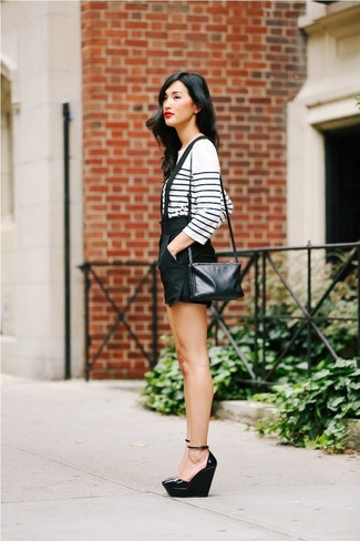 Consider pairing a white and navy horizontal striped long sleeve t-shirt with black shorts for both chic and easy-to-wear look. As for the shoes, go for a pair of black leather wedge pumps. This one is just perfect if you're planning an outfit worth 'gramming.