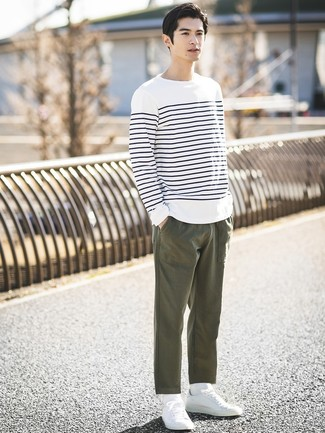 How to wear: white and navy horizontal striped long sleeve t-shirt, olive chinos, white low top sneakers, white socks