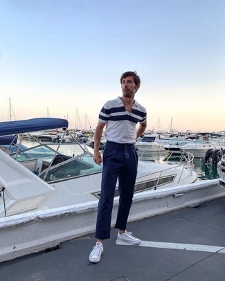 Polo Outfits For Men: A polo and navy chinos are the kind of a never-failing casual getup that you so desperately need when you have no time to dress up. For extra style points, add white canvas low top sneakers to the mix.