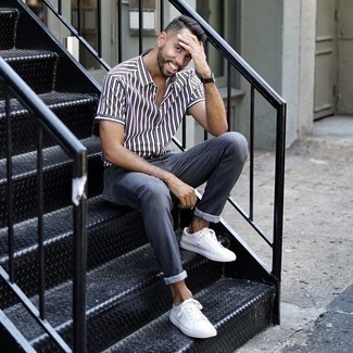 How to Wear Blue Jeans For Men: For a casual menswear style with a fashionable spin, choose a white and navy vertical striped short sleeve shirt and blue jeans. Complement your outfit with a pair of white canvas low top sneakers and you're all done and looking incredible.