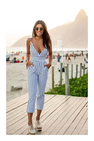 How to wear: white and navy vertical striped jumpsuit, beige leather platform loafers, black sunglasses