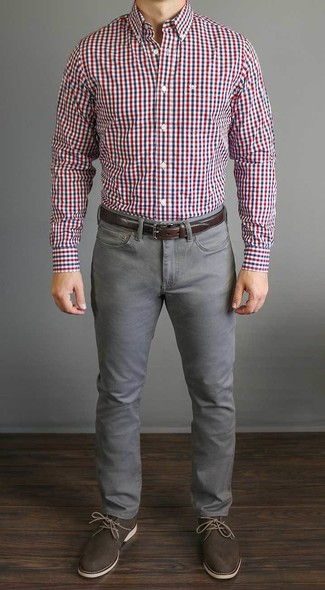 Who said you can't make a style statement with a casual look? Draw the attention in a Tommy Hilfiger men's Slim Fit Red And Blue Multi Check Dress Shirt and grey jeans. Dark brown leather desert boots will bring a classic aesthetic to the getup. No doubt, you're looking at a wonderful pick for a summer day.