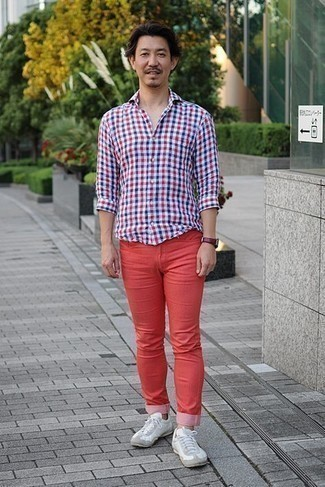 White Leather Low Top Sneakers Outfits For Men: Marrying a white and red and navy gingham long sleeve shirt with red jeans is an awesome pick for a neat and relaxed ensemble. If you're clueless about how to round off, complete this outfit with white leather low top sneakers.