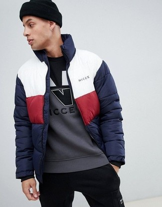 How to wear: white and red and navy puffer jacket, grey print sweatshirt, black sweatpants, black beanie