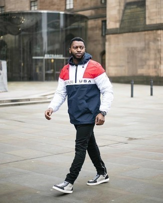 White and Black Leather Shoes with Pants Outfits For Men: This casual combo of a white and red and navy windbreaker and pants couldn't possibly come across other than ridiculously stylish. Finishing off with white and black leather high top sneakers is the simplest way to introduce some extra zing to your outfit.