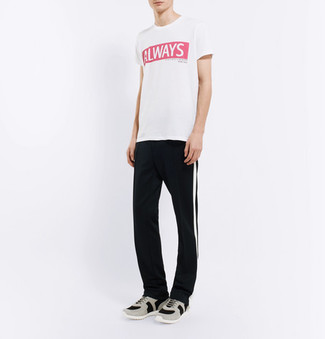 How to wear: white and red print crew-neck t-shirt, black and white vertical striped sweatpants, grey athletic shoes