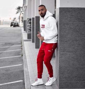How to wear: white and red print hoodie, red sweatpants, white athletic shoes