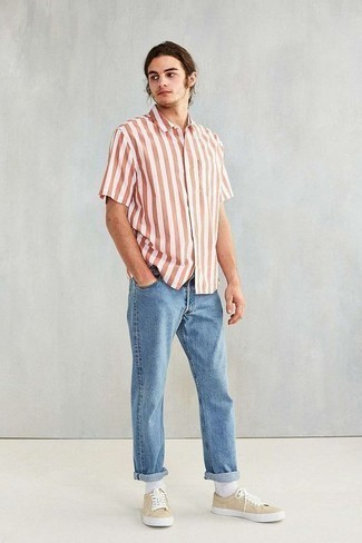 How to Wear a White and Red Vertical Striped Short Sleeve Shirt For Men: If the setting allows a casual menswear style, wear a white and red vertical striped short sleeve shirt and light blue jeans. Beige leather low top sneakers make your ensemble complete.