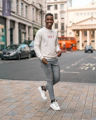 Men's Outfits 2020: To assemble an off-duty menswear style with a modern finish, team a white and red print sweatshirt with grey plaid chinos. Add white and black canvas low top sneakers to the equation and you're all set looking smashing.