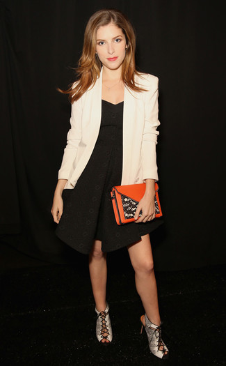 How to wear: white blazer, black fit and flare dress, grey snake leather heeled sandals, orange leather clutch