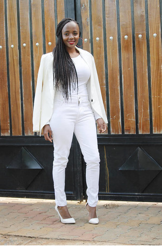 If you're facing a sartorial situation where comfort is prized, consider teaming a white blazer with white skinny jeans. Why not introduce white leather pumps to the mix for an added touch of style? This ensemble is everything for those warm days of spring.