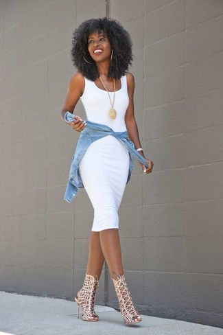 How to wear: white bodycon dress, light blue denim shirt, beige leather gladiator sandals, gold pendant