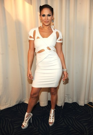 Jennifer Lopez wearing White Cutout Bodycon Dress, White Leather Heeled Sandals, Silver Bracelet, Silver Earrings