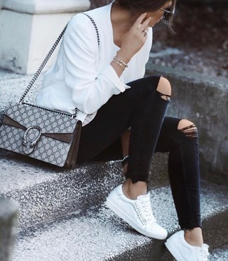 White Bomber Jacket Outfits For Women: A white bomber jacket and black ripped skinny jeans paired together are such a dreamy ensemble for those who appreciate laid-back styles. This look is finished off nicely with white leather low top sneakers.