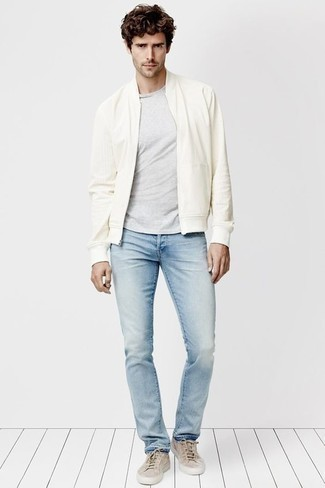 How to Wear a White Bomber Jacket In Your 30s For Men: A white bomber jacket and light blue jeans are the kind of casual must-haves that you can wear for years to come. As for footwear, add beige canvas low top sneakers to this outfit.