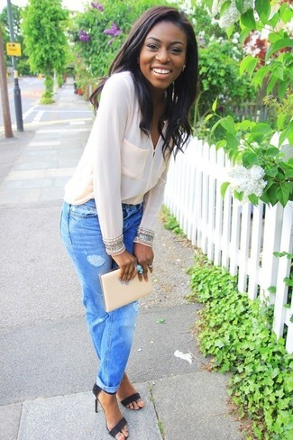Make a white silk button down blouse and light blue boyfriend jeans your outfit choice for a glam and trendy getup. Black suede heeled sandals will bring a classic aesthetic to the ensemble.