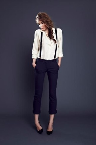 How to wear: white button down blouse, navy skinny pants, black leather pumps, black suspenders