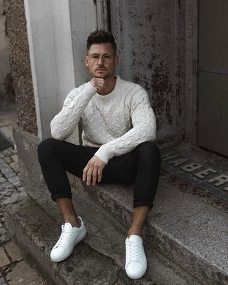 How to Wear a Cable Sweater For Men: Such pieces as a cable sweater and black chinos are the ideal way to infuse some cool into your current casual routine. Put a relaxed spin on your outfit by slipping into a pair of white leather low top sneakers.