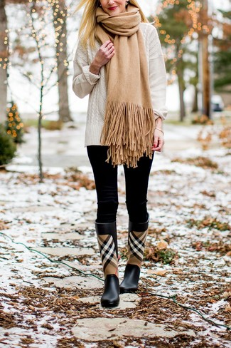Tan Scarf Outfits For Women: Combining a white cable sweater with a tan scarf is an on-point idea for a casual and cool ensemble. For something more on the cool and laid-back end to finish off this look, add black plaid rain boots to this getup.