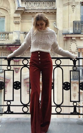 If you like a more relaxed approach to fashion, why not pair a Valentino women's Studded Cable Knit Jumper with burgundy corduroy wide leg pants? Sunnier days call for cooler getups like this one.